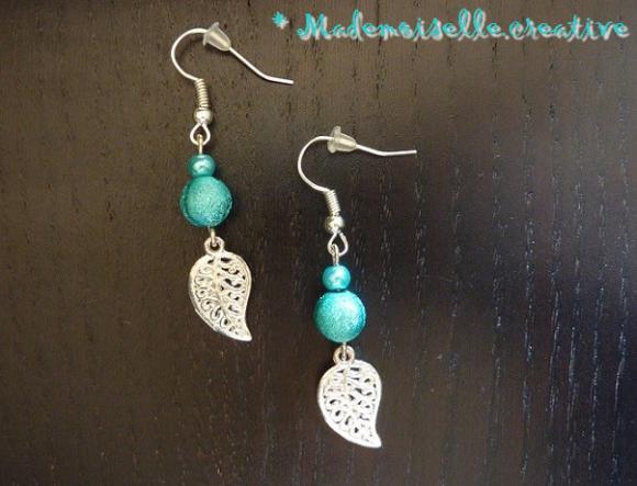 http://mademoiselle.creative.cowblog.fr/images/Bouclesdoreillesperlesbreloque019argentbleufeuille.jpg
